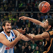 Fenerbahce Ulker's Kaya PEKER (L) during their Turkish Airlines Euroleague Basketball Group A Game 3 match Fenerbahce Ulker between Sluc Nancy at Abdi İpekci Arena in Istanbul, Turkey, Thursday, November 03, 2011. Photo by TURKPIX
