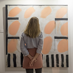 October 5, 2018 - London, UK - LONDON, UK. Artist Rosa Roberts poses with one of her works as part of Not 30%, a sub-exhibition presenting works by female artists. Opening day of The Other Art Fair, presented by Saatchi Art, which runs until 7 October in Bloomsbury.  The fair, which coincides with Frieze Week, is a collection of artworks by independent and emerging artists handpicked by a committee of art world experts.  Visitors and art buyers have the opportunity to meet the artists presenting their work at the fair. (Credit Image: © Stephen Chung/London News Pictures via ZUMA Wire)
