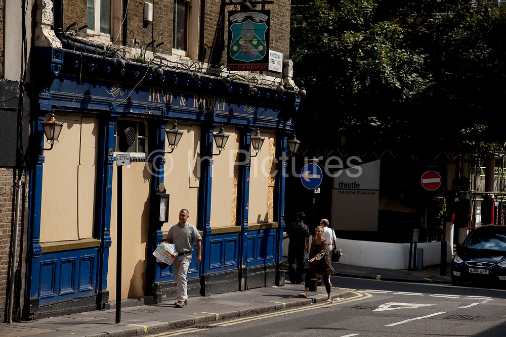 Closed down Britain. The Hand & Raquet pub near Leicester Sq, London. Due to the economic downturn many pubs like this one are now boarded up.