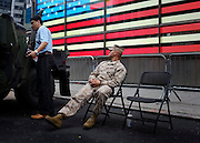 © Licensed to London News Pictures. 27/05/2012. New York, USA. A Member of the US Marines watches a member of public during a recruitment exercise in New York's Times Square today 27 May 2012.  Photo credit : Stephen Simpson/LNP