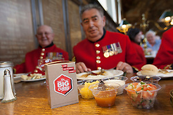 © licensed to London News Pictures. London, UK 02/10/2012. Chelsea Pensioners eating curry meal as they launch The Soldiers' Charity Big Curry season with a special curry lunch at Royal Hospital Chelsea's Royal Hall in London on 02/10/12. (Names: (left to right) Hackett Ray, John Clavim) Photo credit: Tolga Akmen/LNP