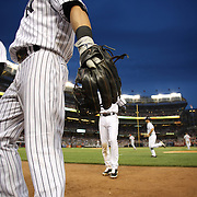 Yankees players head back to the dugout during theNew York Yankees Vs Cincinnati Reds baseball game at Yankee Stadium, The Bronx, New York. 18th July 2014. Photo Tim Clayton