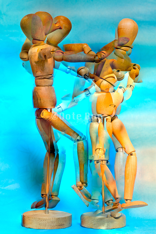 artist modeling doll figurines with a dancing pose