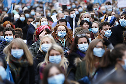 © Licensed to London News Pictures. 06/02/2016. London, UK. Junior doctors and NHS staff staging a masked protest in central London ahead of a 24-hour walkout due to begin on Wednesday as a result of the proposed contract changes offered by the government to junior doctors, on Saturday, 6 February 2016. Photo credit: Tolga Akmen/LNP