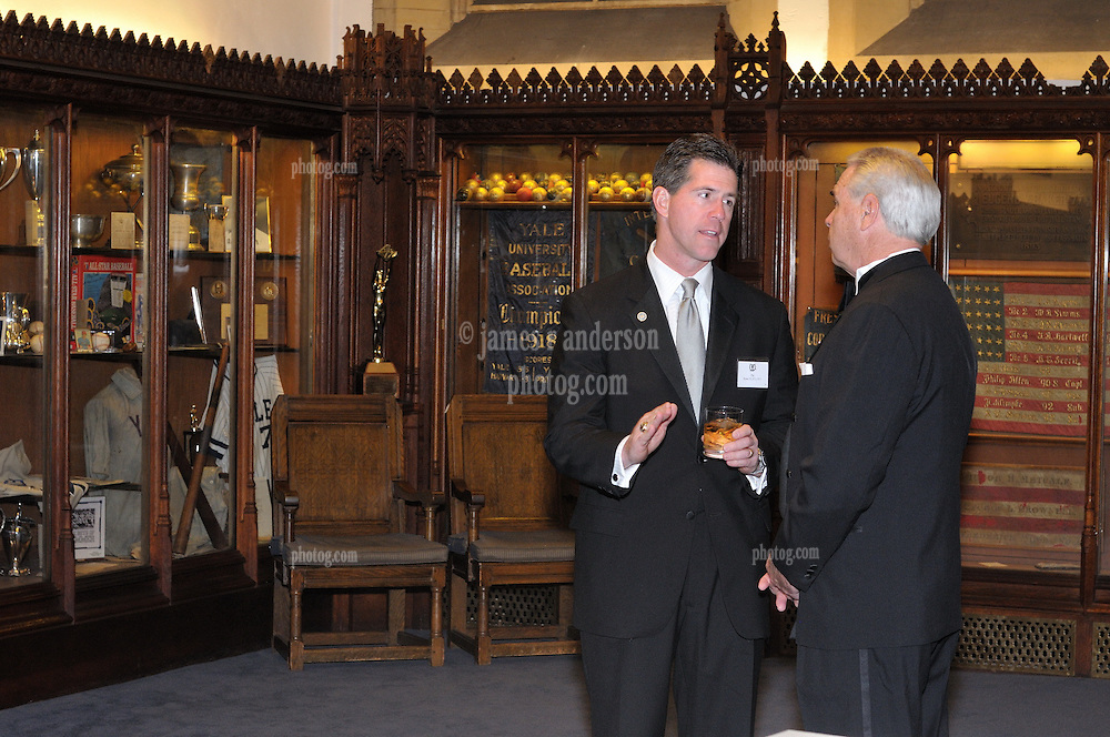 Tom Beckett and Guest at the Cocktail Reception for Yale University Athletics Blue Leadership 2009 Honorees. Kiphuth Trophy Room, Payne Whitney Gym on 20 November '09.