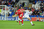 David Vaughan of Wales is tackled by Stevan Jovetic (8). Euro 2012 Qualifying match, Wales v Montenegro at the Cardiff City Stadium in Cardiff  on Friday 2nd Sept 2011. Pic By  Andrew Orchard, Andrew Orchard sports photography,