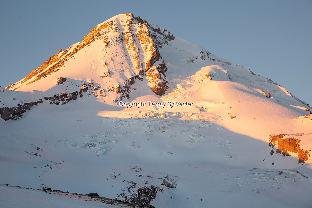 On Thursday, January 31, 2019, morning sunlight illuminates the Cooper Spur ridge and Eliot Glacier on the northeast side of Mount Hood, Oregon, where debris from a plane crash was found in late January. The pilot, George Regis, 63, died in the crash while reportedly flying from his home in Battleground, Washington, to Arizona.