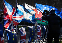 © Licensed to London News Pictures. 28/01/2019. London, UK. A TV news cameraman films EU, UK, Scottish and Welsh flags near Parliament ahead of crucial votes on Brexit amendments. Photo credit: Peter Macdiarmid/LNP