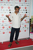 Ezra Froque Khan, Arriving for the screening of Granada Heights, UK Asian Film Festival, hosted at Rich Mix Shoreditch London photo by Terry Scott