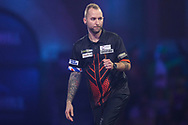 Danny Noppert wins the first set against Kim Huybrechts and celebrates during the PDC William Hill World Darts Championship at Alexandra Palace, London, United Kingdom on 22 December 2019.