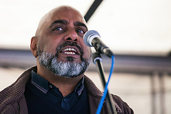 London, UK. 1st December, 2018. Asad Rehman, Executive Director at War on Want, addresses the Together for Climate Justice demonstration against Government policies in relation to climate change, including Heathrow expansion and fracking. Following a rally outside the Polish embassy, chosen to highlight the UN's Katowice Climate Change Conference which begins tomorrow, protesters marched to Downing Street.