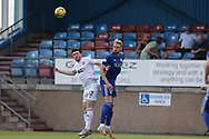 Peterhead's Russell McLean (9) and Cove Rangers' Daniel Higgins (12) battles for possession, tussles, tackles, challenges, during the Premier Sports Scottish League Cup match between Peterhead and Cove Rangers at Balmoor, Peterhead, Scotland on 17 July 2021.