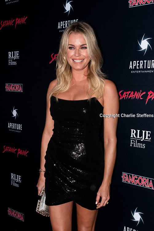 REBECCA ROMIJIN attends the Los Angeles premiere of Satanic Panic at the Egyptian Theatre in Los Angeles, California.