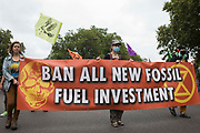 Environmental activists from Extinction Rebellion take part in a Stop The Harm march during the fourth day of Impossible Rebellion protests on 26th August 2021 in London, United Kingdom. Extinction Rebellion are calling on the UK government to cease all new fossil fuel investment with immediate effect.