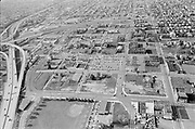 Y-750430B-20A. aerial of Williams Ave. district after Emanuel demolitions. April 30, 1975