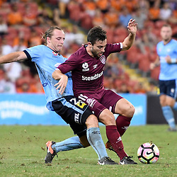 BRISBANE, AUSTRALIA - FEBRUARY 3: Tommy Oar of the Roar is fouled by Rhyan Grant of Sydney during the round 18 Hyundai A-League match between the Brisbane Roar and Sydney FC at Suncorp Stadium on February 3, 2017 in Brisbane, Australia. (Photo by Patrick Kearney/Brisbane Roar)