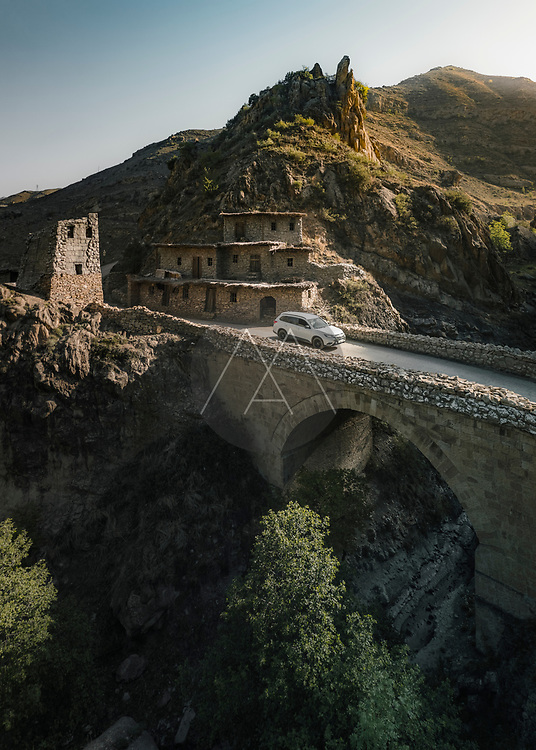 Dagestan, Russia - 15 May 2021: Aerial view of beautiful tower, home and bridge built in Republic of Dagestan, Russia.
