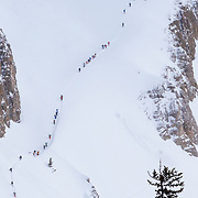 A train of skiers hikes the Headwall traverse inside of Jackson Hole Mountain Resort.