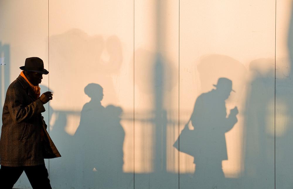 Nederland,  Amsterdam, 28 jan 2011.Man en schaduw in laat middaglicht..Foto (c)  Michiel Wijnbergh