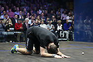 Mathieu Castagnet of France  falls to the floor after beating Omar Mosaad of Egypt  in the final.  the Final, Omar Mosaad of Egypt v Mathieu Castagnet of France , Canary Wharf Squash Classic 2016 , at the East Wintergarden in Canary Wharf , London on Friday 11th March 2016.<br /> pic by John Patrick Fletcher, Andrew Orchard sports photography.