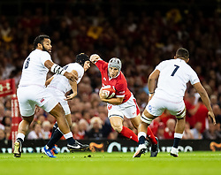 Jonathan Davies of Wales under pressure from  Piers Francis of England<br /> <br /> Photographer Simon King/Replay Images<br /> <br /> Friendly - Wales v England - Saturday 17th August 2019 - Principality Stadium - Cardiff<br /> <br /> World Copyright © Replay Images . All rights reserved. info@replayimages.co.uk - http://replayimages.co.uk