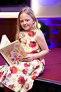 """07/04/2019 repro free: Ella Ward 2nd Class Kiltirenan NS with her book  """"The Teacher with the Crazy Ideas""""  at    Write a Book organised by The Galway Education centre and help at the Salthill Hotel  . Photo: Andrew Downes, Xposure"""