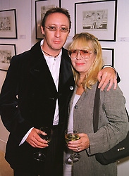 Singer JULIAN LENNON and his mother CYNTHIA LENNON, at an exhibition in London on 2nd June 1999.MST 54