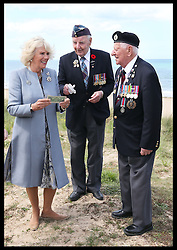 Image ©Licensed to i-Images Picture Agency. The Duchess of Cornwall meets veterans Lloyd Bentley (93) and Stanley Clarkefields (95)  on Juno Beach in Normandy, France, on the eve of the 70th anniversary of DDay, Thursday, 5th June 2014 Picture by Stephen Lock / i-Images