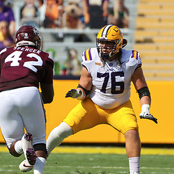 Sep 26, 2020; Baton Rouge, Louisiana, USA; LSU Tigers offensive lineman Austin Deculus (76) blocks against Mississippi State Bulldogs defensive end Marquiss Spencer (42) during the first half at Tiger Stadium. Mandatory Credit: Derick E. Hingle-USA TODAY Sports