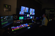 April 2, 2016; Indianapolis, Ind.; Christina Davis is on the screen in the production room during their green screen session at the NCAA Headquarters.