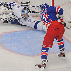 New York Rangers center Artem Anisimov (42) scores past a sprawling save attempt by Tampa Bay Lightning goalie Mathieu Garon (32) during second period NHL action between the Tampa Bay Lightning and the New York Rangers at Madison Square Garden.
