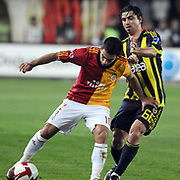 Galatasaray's Arda TURAN (L) and Fenerbahce's Mehmet TOPUZ (R) during their Turkish superleague soccer derby match Galatasaray between Fenerbahce at the AliSamiYen Stadium at Mecidiyekoy in Istanbul Turkey on Sunday, 28 March 2010. Photo by TURKPIX