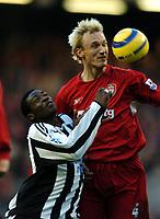 Fotball<br /> Premier League 2004/05<br /> Liverpool v Newcastle<br /> 18. desember 2004<br /> Foto: Digitalsport<br /> NORWAY ONLY<br /> Sami Hyypia<br /> Liverpool 2004/05<br /> Shola Ameobi Newcastle United