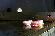 Gruissan village. La Clape. Languedoc. Restaurant La Cranquette. Tuna fish fried grilled. France. Europe.