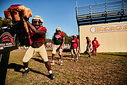 ORADELL, NJ - October 14: Every practice the Defensive Line starts on the Bull Sled. Players continue to practice social distancing when they are not engaged in head to head play.<br /> <br /> We are in the midst of witnessing something this world has never experienced - a global pandemic. The coronavirus has swept away the world in March of 2020 - since then, the world we know It hasn't been the same. Jobs, businesses and futures have been put on hold and lost, yet, we have to power through to overcome one of the greatest obstacles this we have faced. The high school football season wasn't suppose to happen, but a glimmer of hope, intense safety measures & a little bit of luck has allowed for the season to start, now the question is ' Can It be completed?'<br /> <br /> Photo by Johnnie Izquierdo