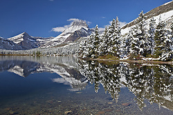 Mt. Wilbur reflection in Swiftcurrent Lake up Many Glacier Canyon in Glacier National Park