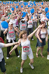 Crowd doing warm up exercises for 2006 Cancer Research UK Race for Life; Nottingham,