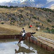 Lauren Buckley riding Icey Storm in action at the water jump during the Cross Country event at the Wakatipu One Day Horse Trials at the Pony Club grounds,  Queenstown, Otago, New Zealand. 15th January 2012. Photo Tim Clayton