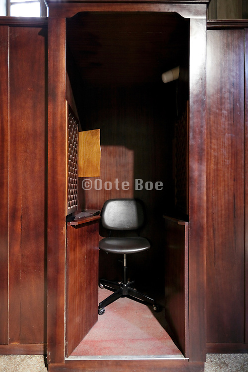 chair inside a confession booth