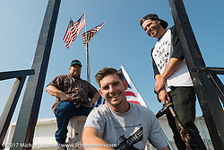 The Ives family on the wall with Dad up top, Kyle Ives in the foreground and brother Cody Ives (R) during the annual Sturgis Black Hills Motorcycle Rally.  SD, USA. Saturday August 12, 2017. Photography ©2017 Michael Lichter.