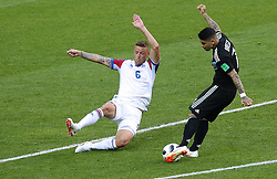 June 16, 2018 - Moscou, Rússia - MOSCOU, MO - 16.06.2018: ARGENTINA VS ICELAND - Ragnar SIGURDSSON of Iceland dispute ball with Ever BANEGA of Argentina during the match between Argentina and Iceland valid for the 2018 World Cup held at the Otkrytie Arena (Spartak) in Moscow, Russia. (Credit Image: © Rodolfo Buhrer/Fotoarena via ZUMA Press)