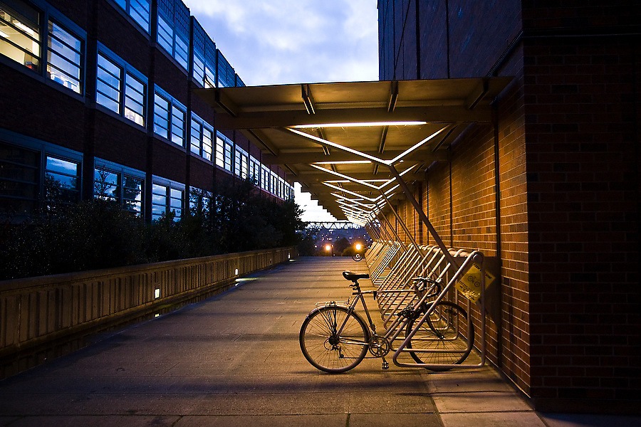 A road bicycle sits alone, locked to a bike rack on the University of Washington campus in Seattle, Washington.