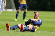 Jack Wilshere of Arsenal holds his chest as he takes a hit while in action for the Arsenal u21 team. Barclays U21Premier league match, Swansea city U21's v Arsenal U21's at the Landore training ground in Swansea, South Wales on Thursday 14th April 2016.<br /> pic by Andrew Orchard, Andrew Orchard sports photography.