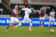 Modou Barrow of Swansea city makes a break. Barclays Premier league match, Swansea city v Aston Villa at the Liberty Stadium in Swansea, South Wales on Saturday 19th March 2016.<br /> pic by  Andrew Orchard, Andrew Orchard sports photography.