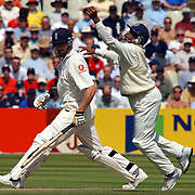 Sri Lanka's Hashan Tillakaratne leaps up to catch out England's Andrew Flintoff.