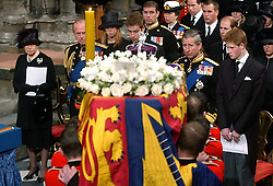 File photo dated 09/04/02 of the Royal family as pall bearers carry the coffin of Queen Elizabeth the Queen Mother at Westminster Abbey during her funeral service. The Queen mother's funeral was the last royal funeral to be extensively televised in the UK. Issue date: Friday April 16, 2021.