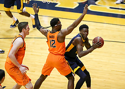 Feb 10, 2018; Morgantown, WV, USA; West Virginia Mountaineers forward Wesley Harris (21) drives baseline against Oklahoma State Cowboys forward Cameron McGriff (12) during the first half at WVU Coliseum. Mandatory Credit: Ben Queen-USA TODAY Sports