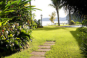 Private home in Parati Brazil. Garden path leading to the pool.