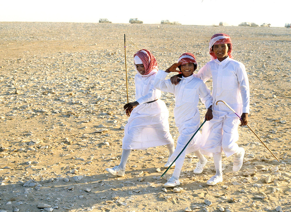 Three young jockeys seen at the camels races in Abu Dhabi, United Arab Emirates. Photograph by Jayne Fincher