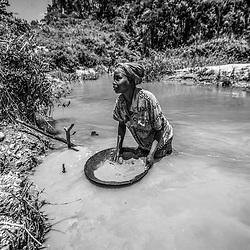 Fea0093883. DT News.Tananarive a mining village near AMBATONDRAZAKA,The Ankeniheny-Zahamena Corridor, Madagascar.Pic Shows a young woman panning for gold in a mine close to Tananarive